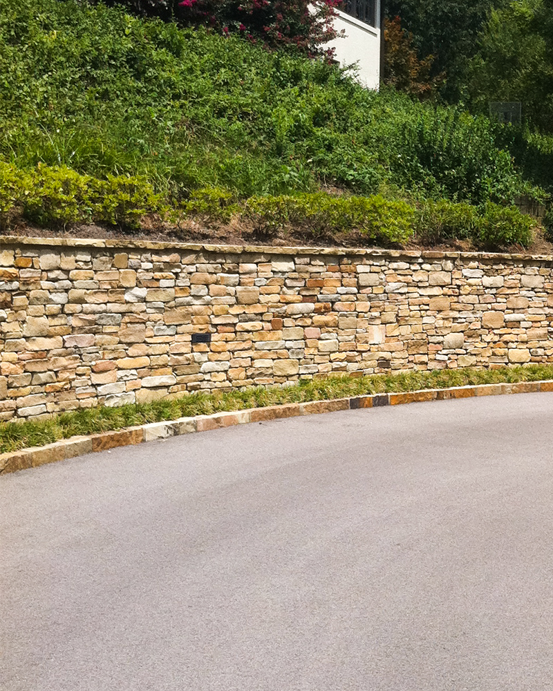 Earthtone Building Stone Wall with 2in Earthtone Wall Coping and Earthone Driveway Curbing