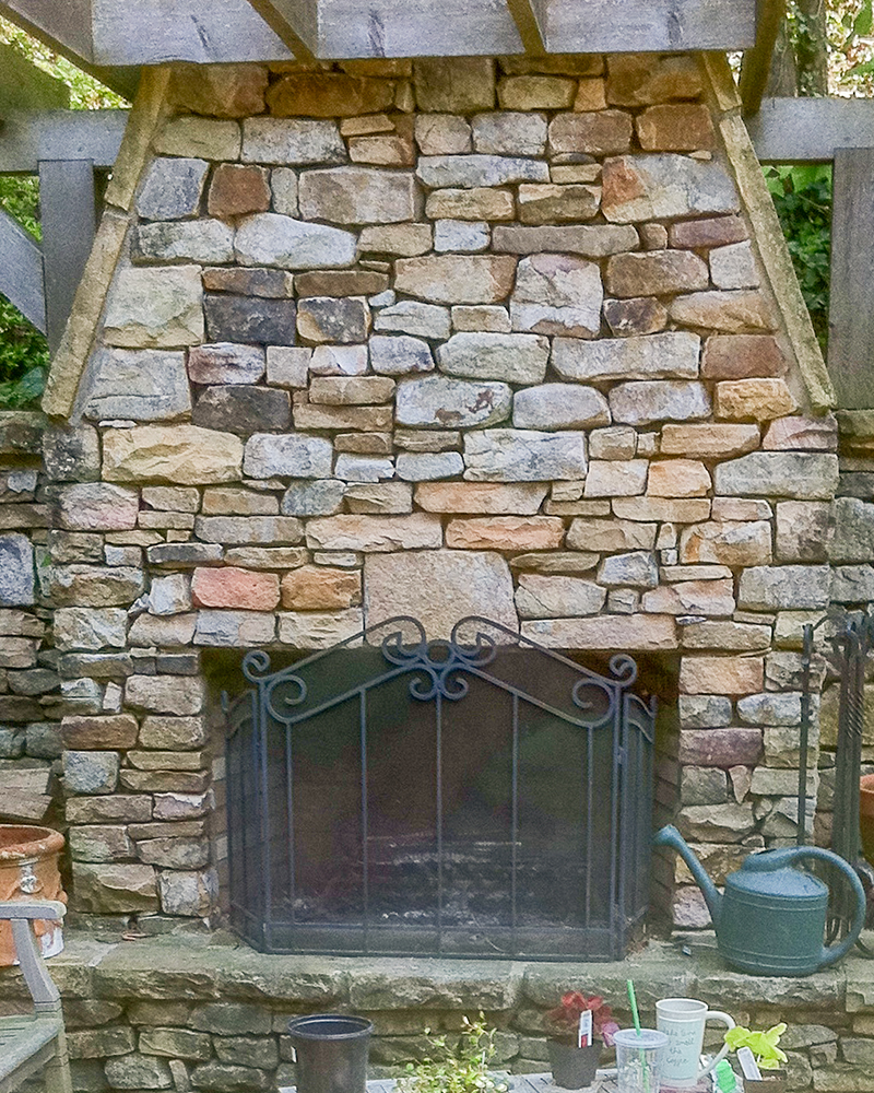 Medium Stack Moss Rock (Fieldstone) On Outdoor Fireplace