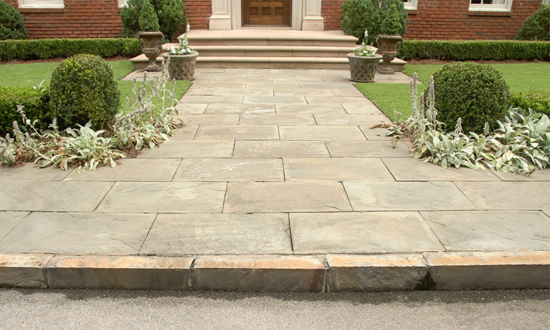 Aged Full Color Natural Cleft Pennsylvania Bluestone Butt Jointed Laid in a Running Bond Pattern