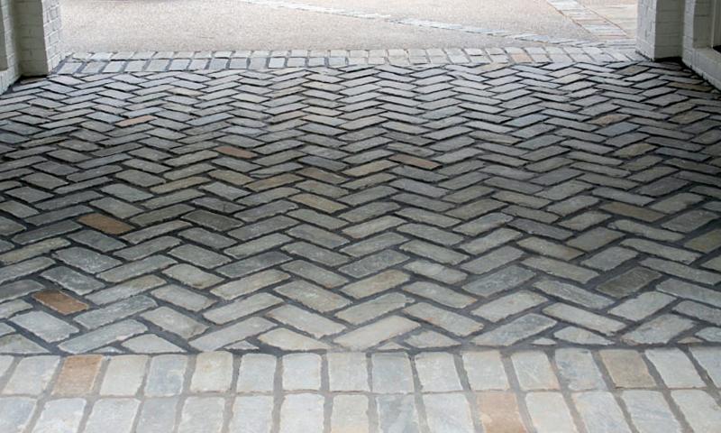 Blue Grey Sandstone Cobblestones Laid In A Herringbone Pattern