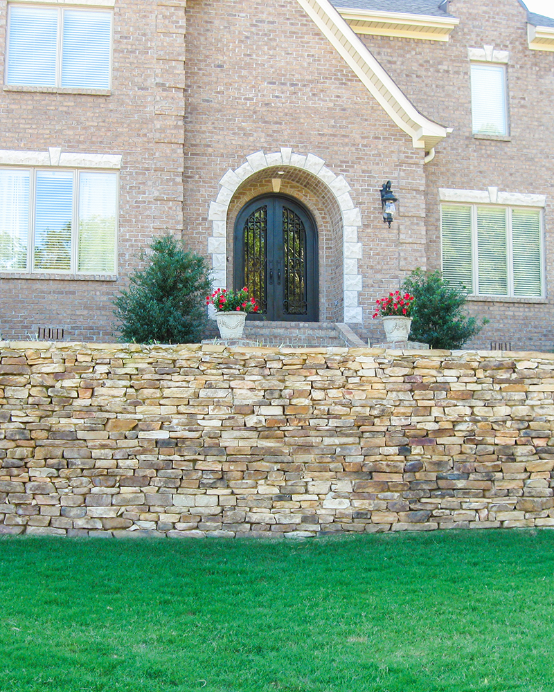 Dry Stacked Medium Longstack Moss Rock (Fieldstone) Retaining Wall
