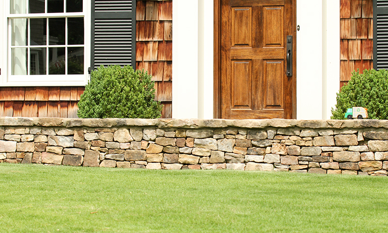 Medium Stack and Medium Long Stack Moss Rock (Fieldstone) Landscaping Wall